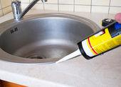 Sink and silicone sealant — Stock Photo
