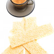 Cappuccino and wafer bread over white - ストック写真