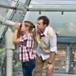 Father and daughter looking through tourist telescope , explorin — Stock Photo