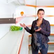 Young woman leans against empty shelves in shop — Stock Photo #6489549