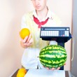 Man weighing watermelon at the market — Stock Photo #6489622