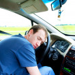 Man sleeps in a car - Stockfoto