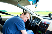 Man sleeps in a car — Stock Photo