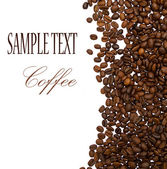 Kávová zrna s ukázkovým textem — Stock fotografie