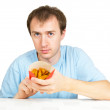Man eats French fries isolated on white — Stock Photo #6603099