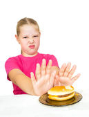 Girl refuses hamburger isolated on white — Stock Photo