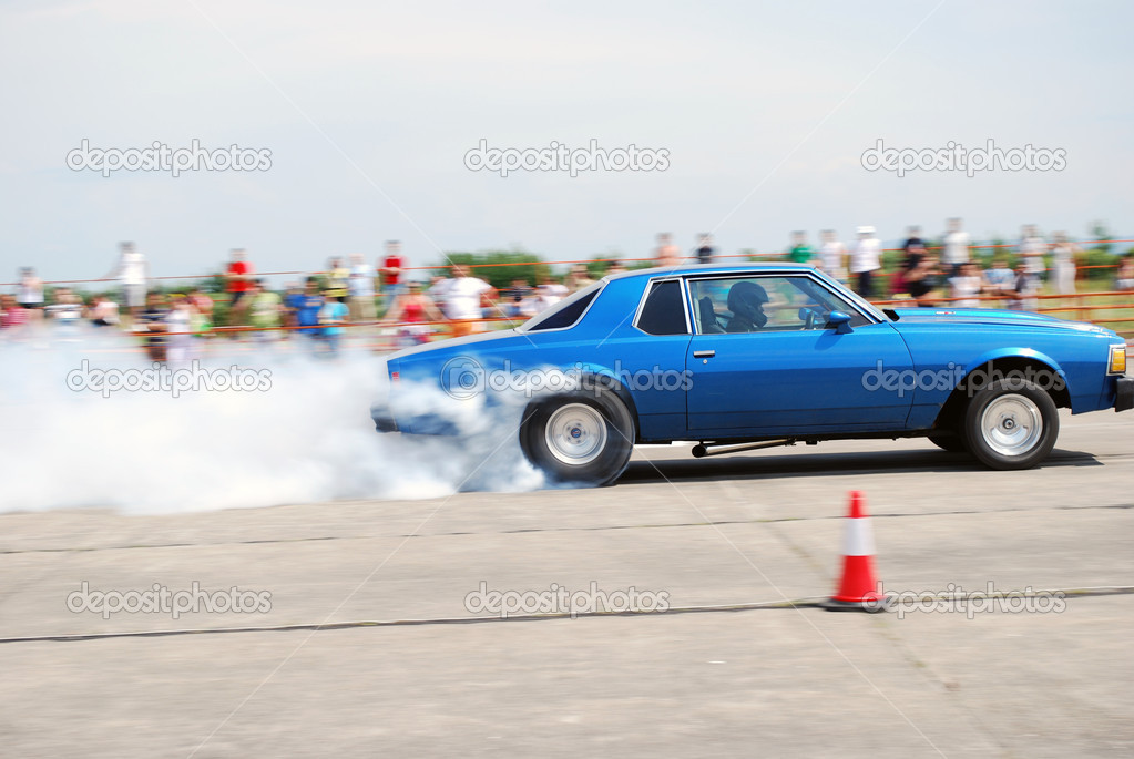 Chevrolet Caprice burnout, in drag race event Satu Mare airport Romania 3 July 2010  Stock Photo #5785024