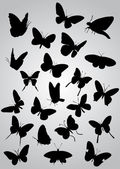 Siluetas de mariposa — Vector de stock