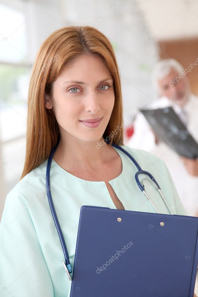 Portrait of beautiful nurse standing in hospital  Stock Photo #5687669