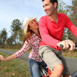 Couple riding bicycles in countryside — Stock Photo #5695714