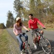 Couple riding bicycles in countryside — Stock Photo #5695720