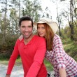 Couple riding bicycles in countryside — Stock Photo