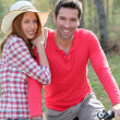 Foto Stock: Couple riding bicycles in countryside