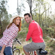 Stock Photo: Couple riding bicycles in countryside