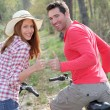 Couple riding bicycles in countryside — Stock Photo #5695727