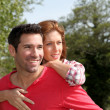 Man holding girlfriend on his back — Stock Photo #5695733