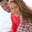 Portrait of smiling couple standing by a lake — Stock Photo #5695735