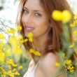 portrait of beautiful woman in besen-feld — Stockfoto #5695767