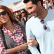 Couple shopping in outdoor market — Stock Photo