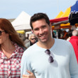 Couple shopping in outdoor market — Stock Photo #5695772