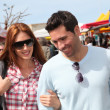 Couple shopping in outdoor market — Foto de stock #5695774