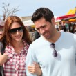 Couple shopping in outdoor market — Stock Photo #5695774