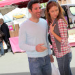 Couple shopping in outdoor market — Stock Photo #5695780