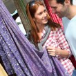 Couple shopping in outdoor market — Stock Photo #5695782