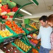 Couple at the supermarket doing grocery shopping — Stock Photo #5695788