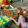 Woman at the grocery store buying fruits and vegetables — Stock Photo #5695795