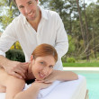 Stock Photo: Beautiful woman laying on a massage bed
