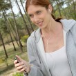 Stock Photo: Beautiful woman jogging in forest