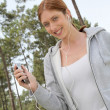 Beautiful woman jogging in forest — Stock Photo #5695889