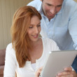 Couple at home using electronic tablet — Stock Photo #5695928