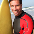 Portrait of young man with surfboard — Stock Photo