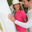 Couple standing on a surfshop — Stock Photo #5696049