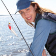 Portrait of woman with fishing rod — Stock Photo