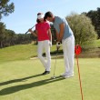 Couple playing golf on a sunny day — Stockfoto