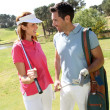 Couple playing golf on a sunny day — Foto Stock