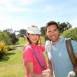 Couple playing golf on a sunny day — Stock fotografie