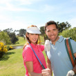 Royalty-Free Stock Photo: Couple playing golf on a sunny day