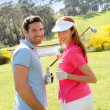 Couple playing golf on a sunny day — Stock Photo #5696204