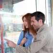 Couple looking at real-estate ads in town — Stock Photo