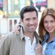 Happy couple doing shopping in town — Stock Photo #5696243
