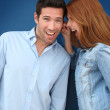 Woman pulling on her boyfriend's ears — Stockfoto #5696414