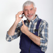 Portrait of artisan with mobile phone — Stock Photo