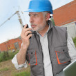 Stock Photo: Construction manager on building site with laptop computer