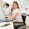 Handicapped womin office — Stock Photo #5696794