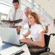 Handicapped woman attending a meeting in office — Stock Photo #5696821