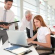 Handicapped woman attending a meeting in office — Stock Photo #5696823